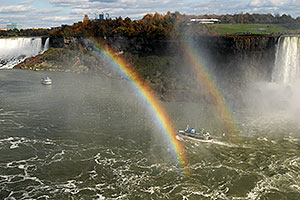 boat within double rainbow heading from Canadian Falls (right) to US Falls (left)