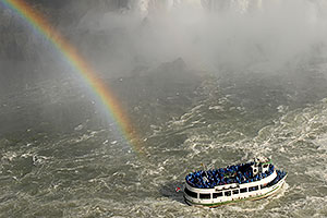 Maid of Mist tour boat heading closer to Niagara Falls