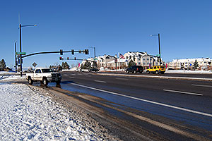 cars at Lincoln and Yosemite Rd in Lone Tree