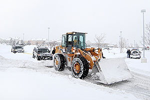 Front Loader Snowplow rescuing two Police Hummers