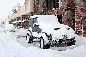 Jeep Wrangler by Safeway during December snowstorm