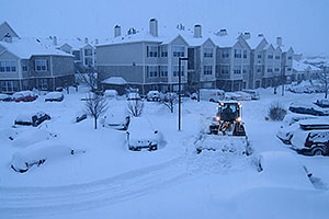 snowplow and cars during a December snowstorm