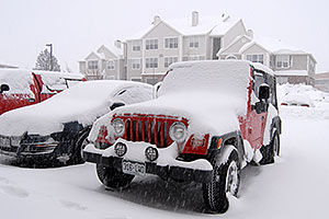 red Jeep Wrangler at Remington during December snowstorm