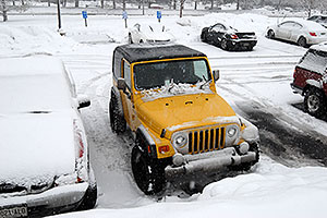 yellow Jeep Wrangler in Englewood
