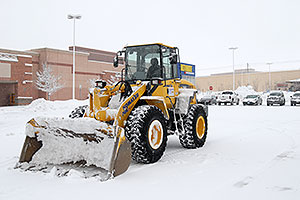 Komatsu Front Loader in front of Ultimate Electronics in Englewood, Colorado