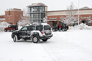 Xterra and and red and blue Jeep Wranglers in front of REI #61 in Englewood, Colorado