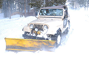 Jeep Wrangler with a snowplow