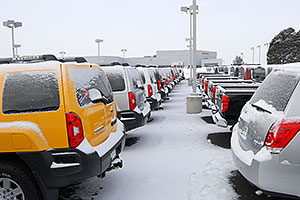 yellow Nissan Xterra and others at GO Nissan on Arapahoe Rd
