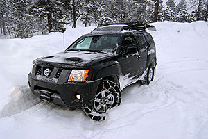 my Xterra with a single snowchain in a snowstorm by Sedalia