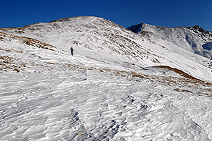 skier walking up east face of Loveland Pass