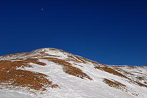 moon over summit of east face of Loveland Pass