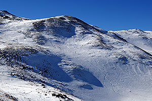 skiers walking up west face of Loveland Pass