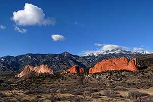 view of Garden of the Gods with Pikes Peak in the clouds