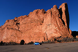 blue VW bug in front of rock of Kissing Camels