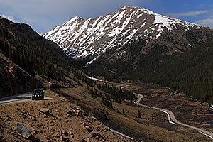 green Land Rover with Mount Champion at 13,646 ft … road down the Twin Lakes side of  Independence Pass