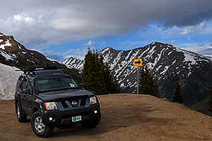 Xterra posing near top of Independence Pass Road, with Mount Champion at 13,646 ft