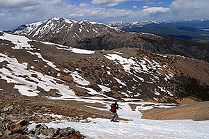 Skier skiing down Mt Elbert … view of Mt Massive at 14,421 ft