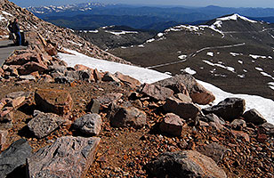 view from 14,133 ft parking lot of Mt Evans  - the snow outlined trail is a road up Mt Evans