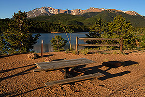 Picnic table at Crystal Reservoir with Pikes Peak in the background