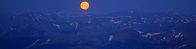 Moon over mountains - view South, South-East along Mt Evans Road, around 14,000 ft