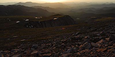 Morning Silhouettes of mountains and parked cars along Mount Evans Road