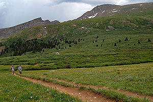 Hikers returning from Mt Bierstadt (14,060 ft, on the right) … The Sawtooth (13,780 ft, on the left)