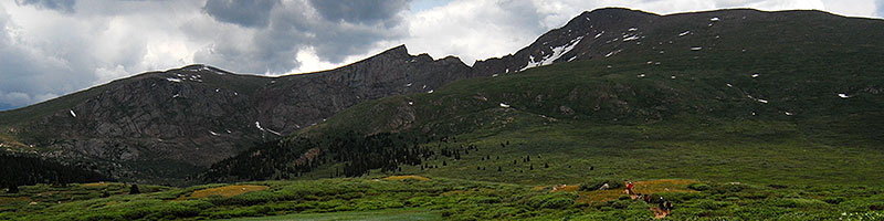 Hikers returning from Mt Bierstadt (14,060 ft, right) … Mt Spalding (13,842 ft, left), The Sawtooth (13,780 ft, middle)
