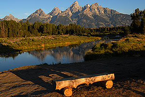 Bench in front of Snake River with Tetons in the morning