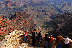 Girl in pink and people enjoying views from Lookout Studio in Grand Canyon
