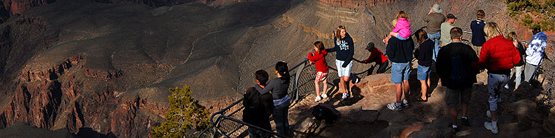 People enjoying views from Yavapai Point in Grand Canyon