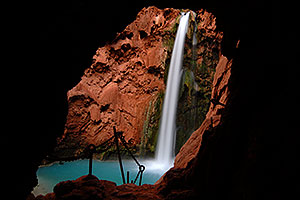 View of Mooney Falls - 210 ft drop (64 meters) - from one of two caves along a steep vertical trail with chains