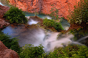 A spring flowing into Havasu Creek below - near Mooney Falls