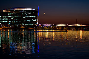 8 person sculling boat at Tempe Town Lake under a crescent moon