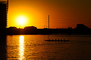 Canoeists during sunset at North Bank Boat Ramp at Tempe Town Lake