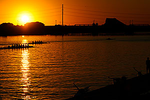 8 scull and 4 scull boats at sunset at the docks of North Bank Boat Ramp at Tempe Town Lake