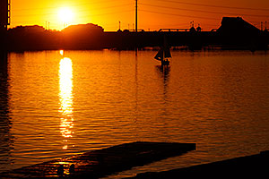 Sailboat at sunset at North Bank Boat Ramp at Tempe Town Lake