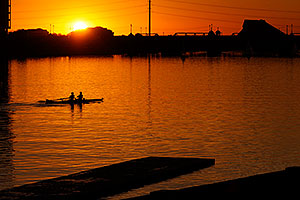 Scullers at sunset at North Bank Boat Ramp at Tempe Town Lake
