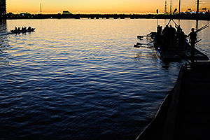 Scullers after sunset at North Bank Boat Ramp at Tempe Town Lake