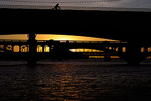 Cyclist on Mill Road bridge over Tempe Town Lake