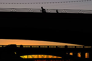 Runners on Mill Road bridge over Tempe Town Lake