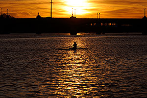 Sculler at sunset on Mill Road bridge over Tempe Town Lake