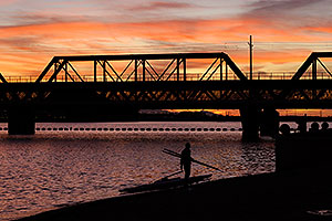 Sculler at sunset on North Bank Boat Beach at Tempe Town Lake