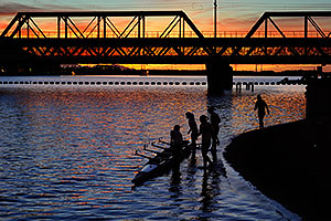 Scullers at sunset on North Bank Boat Beach at Tempe Town Lake
