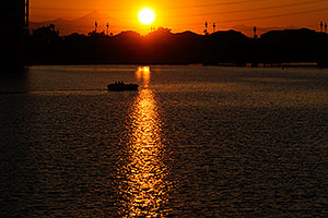 Boat at sunset at Tempe Town Lake