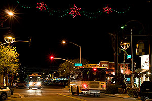 Trolley busses at night at Scottsdale Road and Main St