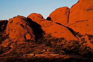 Ramada by the Buttes of Papago Park and a hiker on top