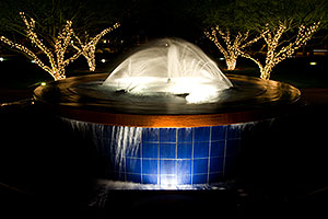 Fountain in a park by Arizona Center at night in Phoenix