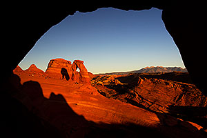 View of Delicate Arch through a window in Arches National Park