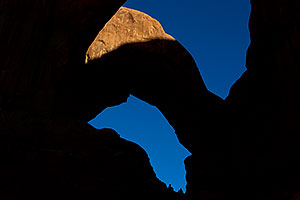 People at Double Arch in Arches National Park
