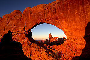 Photographer Silhouette and Turret Arch through North Window in Arches National Park